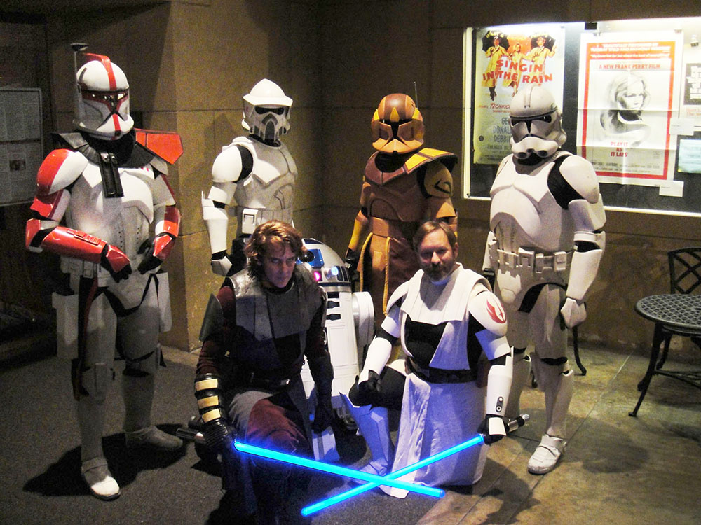 Costumed ticket-holders waiting in line to see Star Wars in theatres